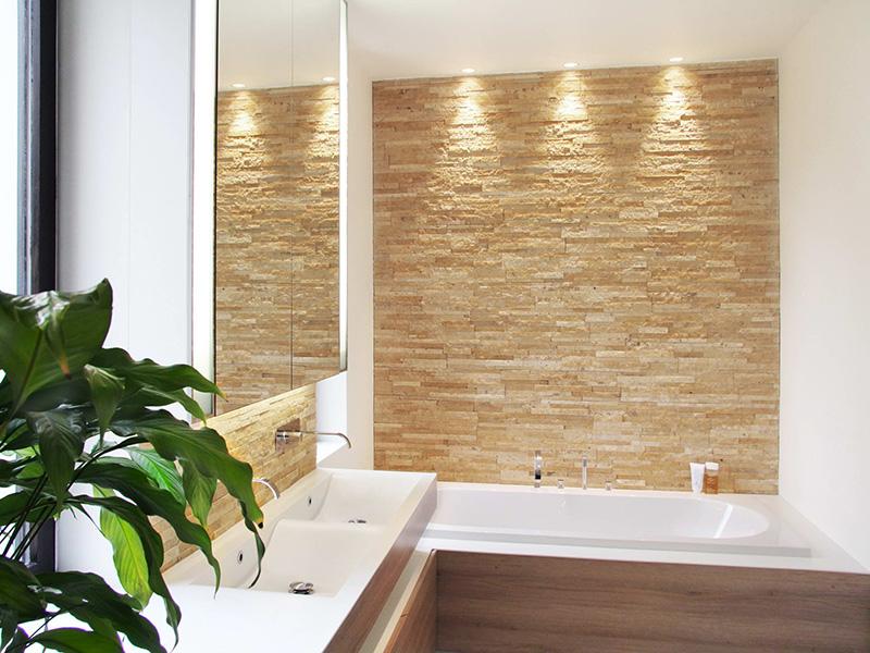 Rénovation complète d'une double salle de bain à Uccle. Conception meubles sur-mesure, vasque en corian. Architecture d'intérieur Odyssée Studio